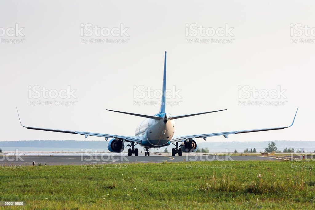 Airplane turns on Runway. Back view royalty-free stock photo