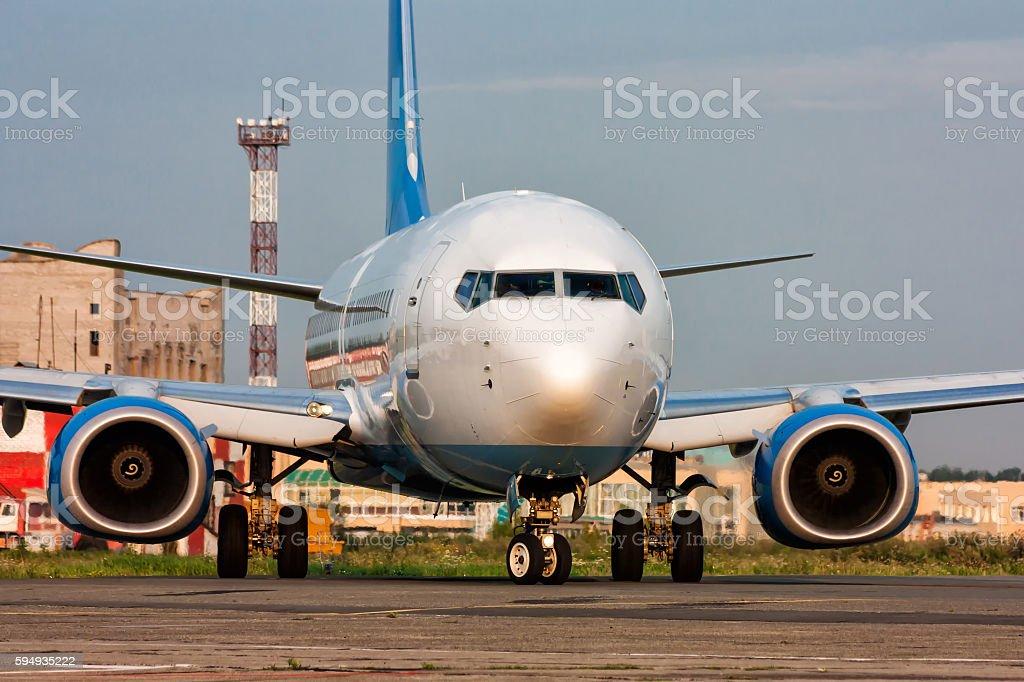 Airplane turns on Runway royalty-free stock photo