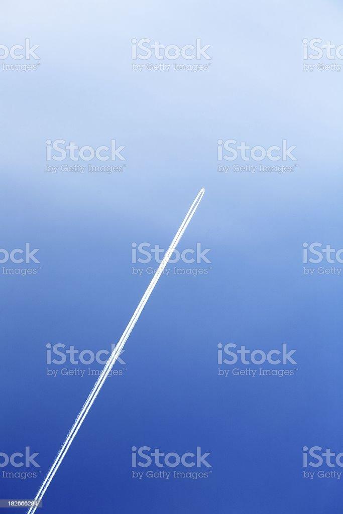 Airplane vapor trail royalty-free stock photo