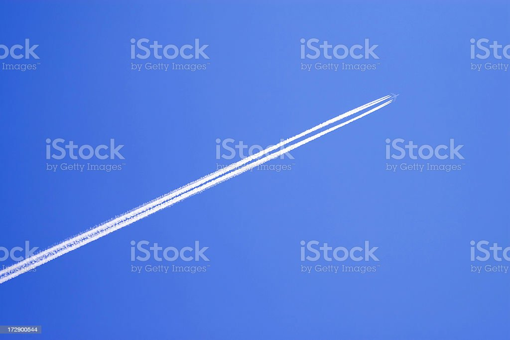 Airplane vapor trails royalty-free stock photo