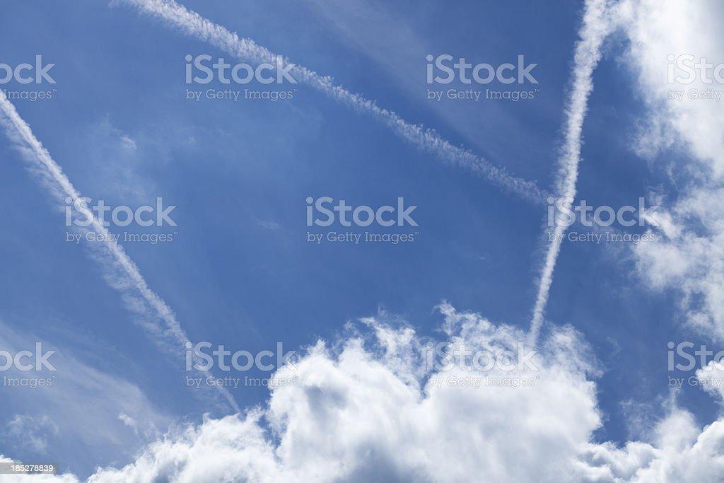 Airplane vapor trails royalty-free stock photo