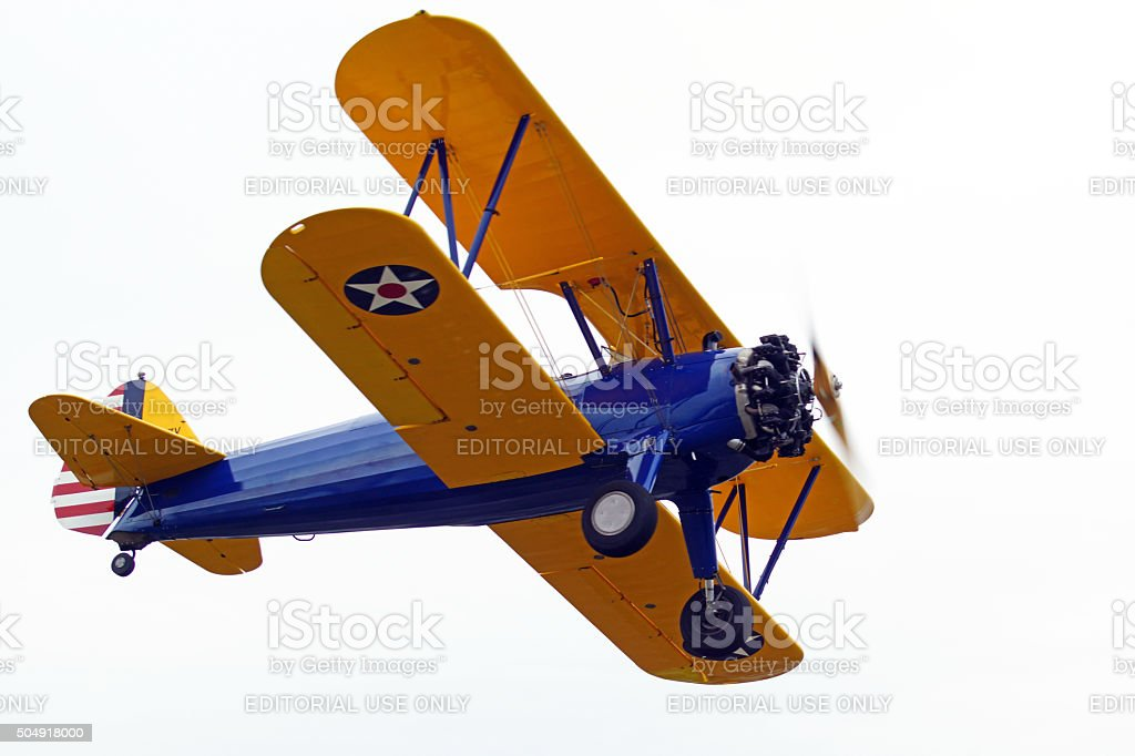 Airplane vintage bi-plane flying at air show stock photo
