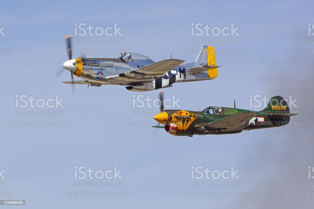 Airplane vintage WWII aircraft flying at air show stock photo