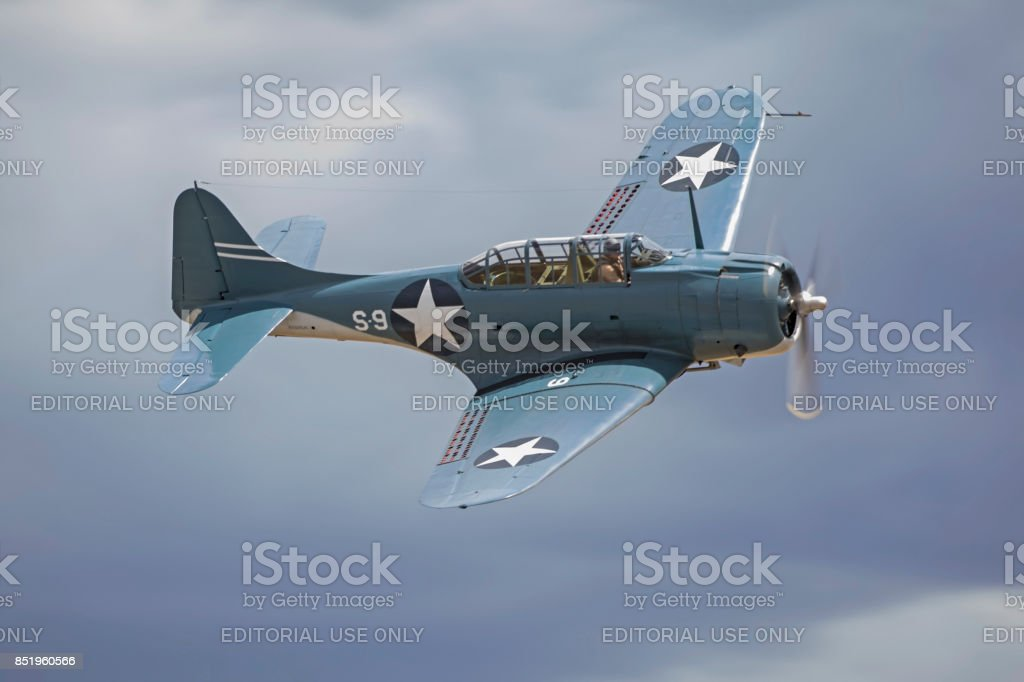 Airplane vintage WWII SBD Dauntless aircraft flying at the airshow stock photo