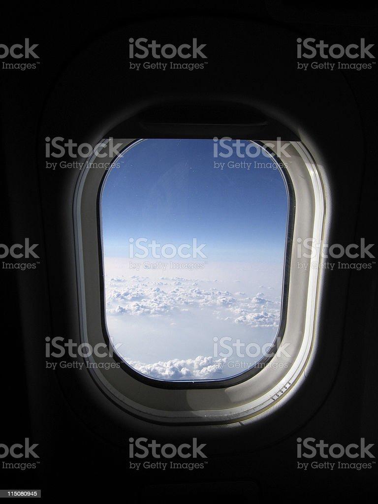 Airplane window view -- clouds, sky stock photo