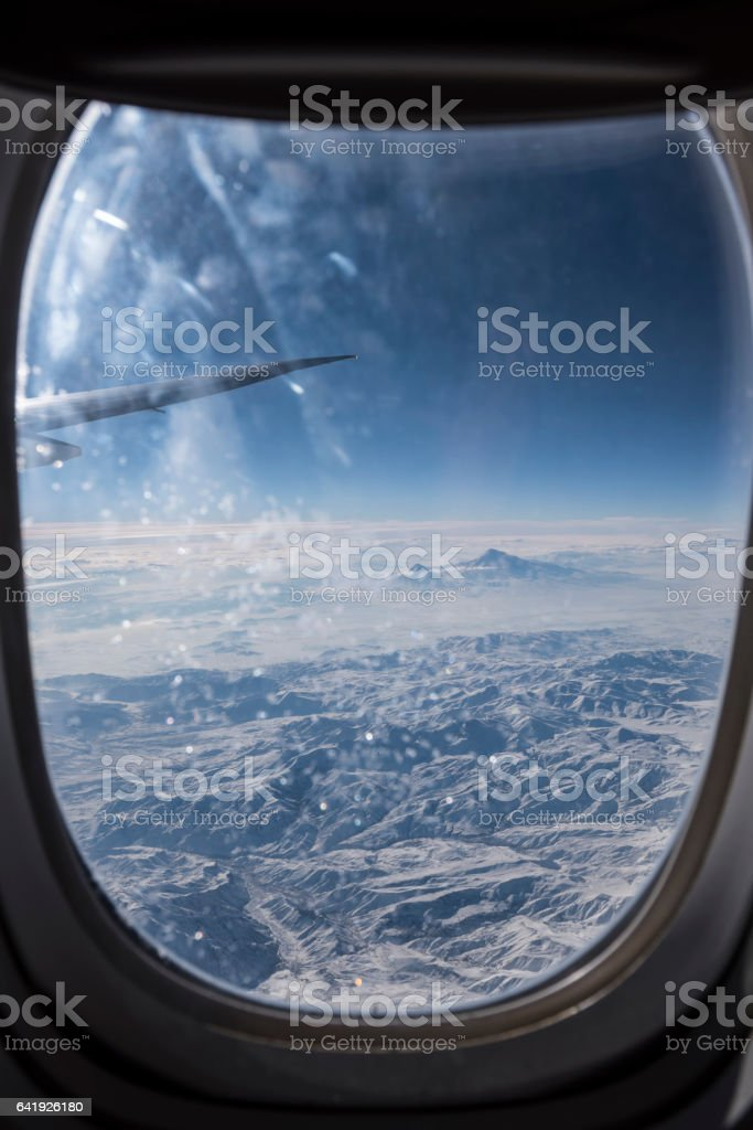Airplane window view of Armenia winter landscape, including Mt Ararat stock photo