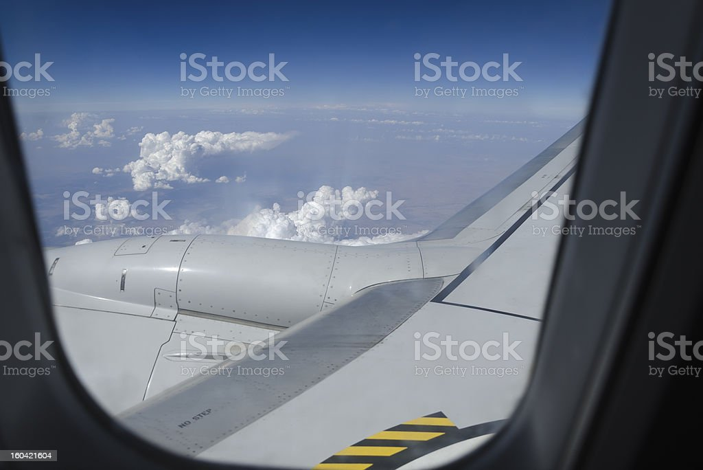 Airplane window with a view of sky and clouds. royalty-free stock photo