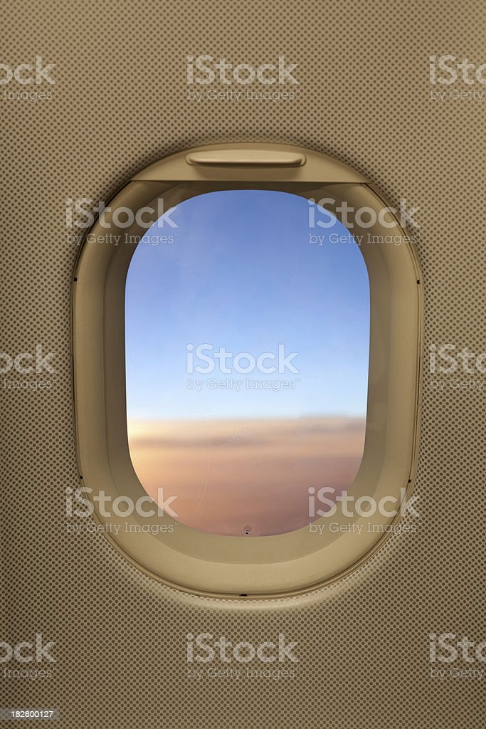 Airplane window with sunset royalty-free stock photo