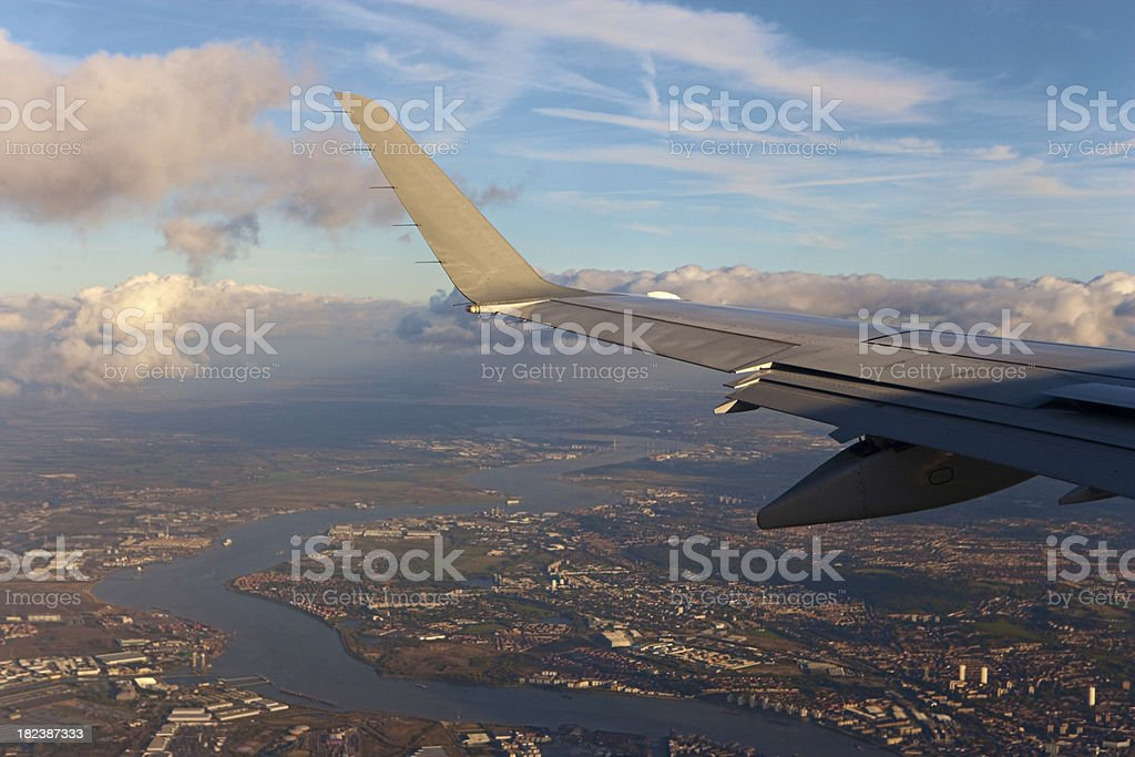 Airplane wing and the blue sky royalty-free stock photo