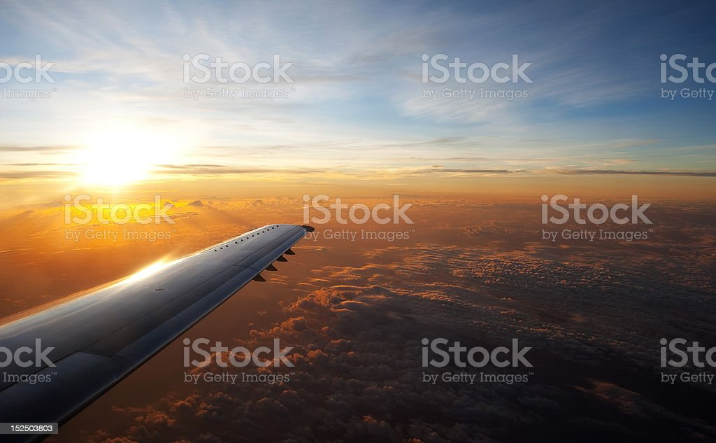 Airplane Wing at Sunrise royalty-free stock photo