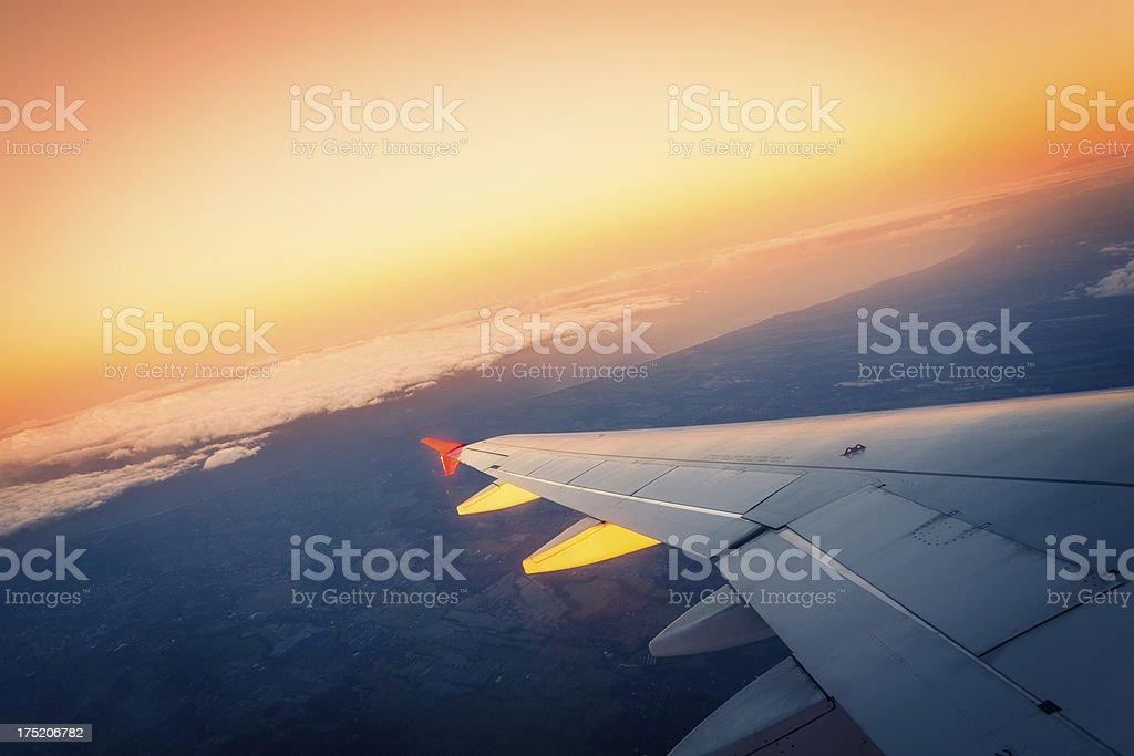 Airplane Wing at Sunset royalty-free stock photo