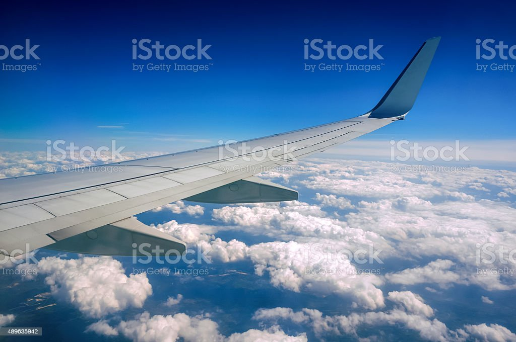 Airplane Wing in Flight at high altitude stock photo