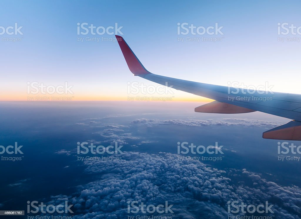 Airplane Wing in Flight stock photo