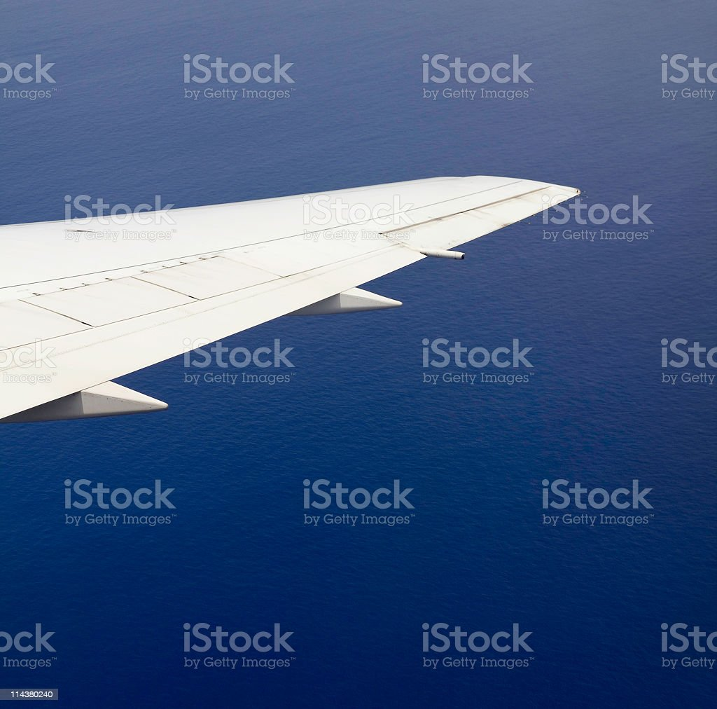 Airplane Wing Over Ocean stock photo