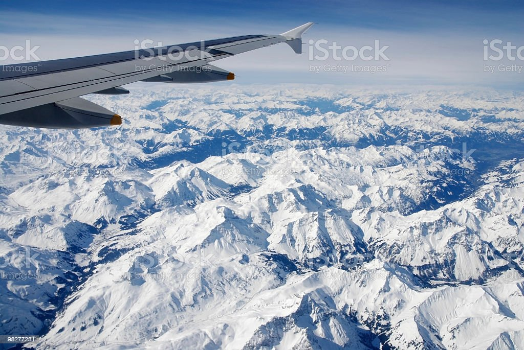 airplane wing over snow covered Apls royalty-free stock photo