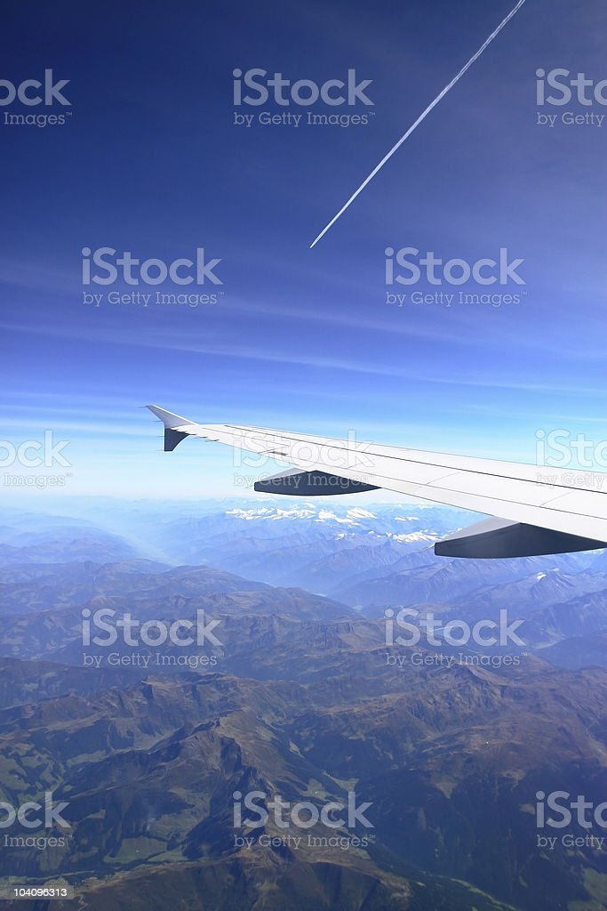 Airplane wing over the alps royalty-free stock photo
