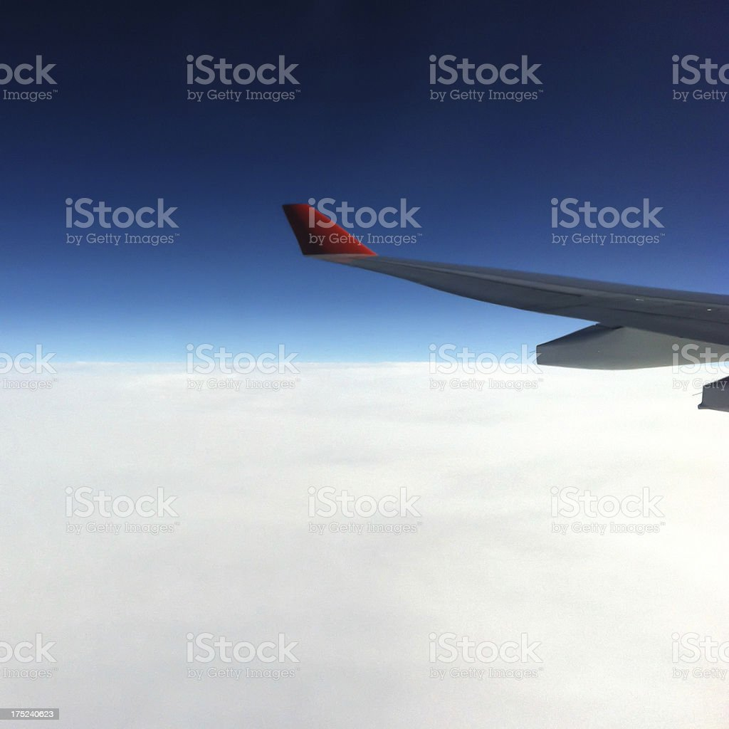 Airplane wing view from cabin window royalty-free stock photo
