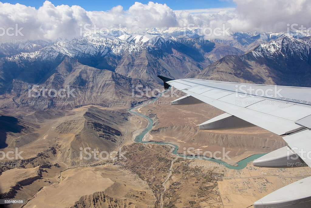 Airplane wing with Leh city stock photo