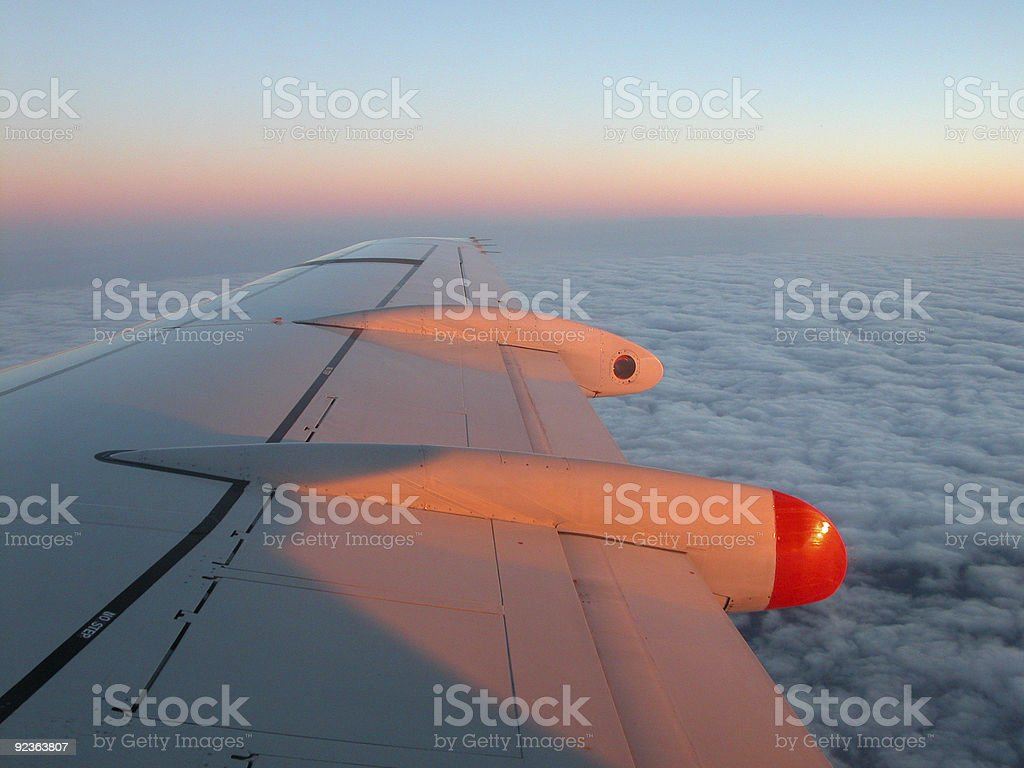 Airplane wings on sunset royalty-free stock photo