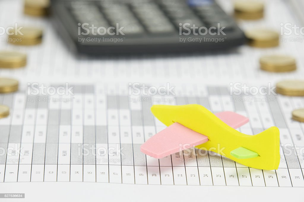 Airplane with blur calculator as background stock photo