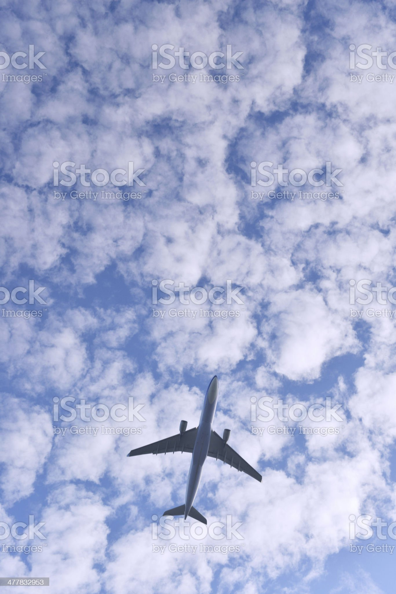 Airplane with cloudy sky royalty-free stock photo