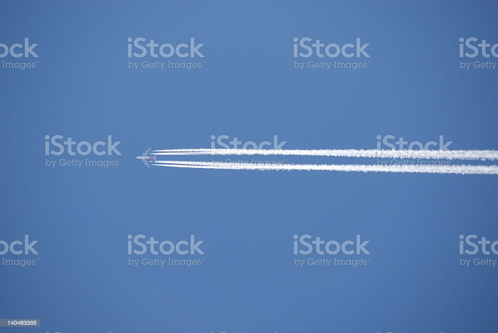 Airplane with contrail royalty-free stock photo