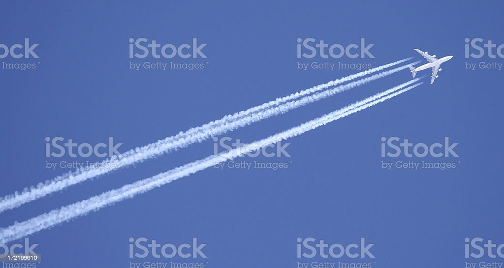 Airplane with contrails stock photo