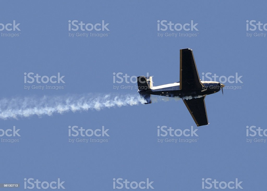Airplane with smoke trail royalty-free stock photo