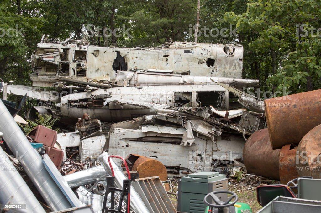 Airplane wreckage in junkyard stock photo