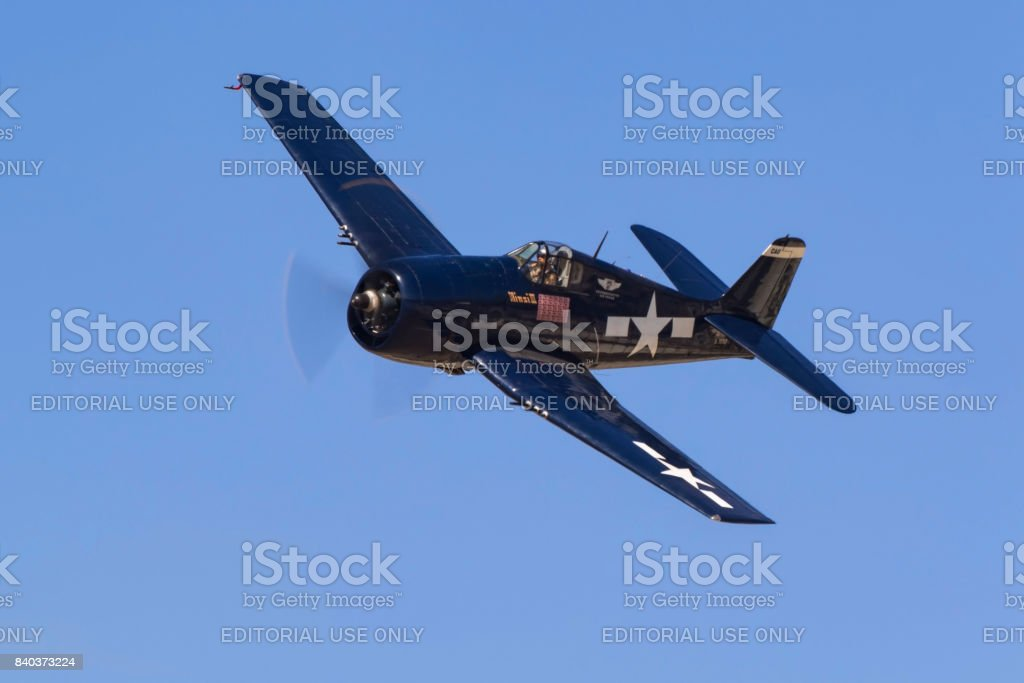 Airplane WWII F6F Hellcat fighter flying at airshow stock photo