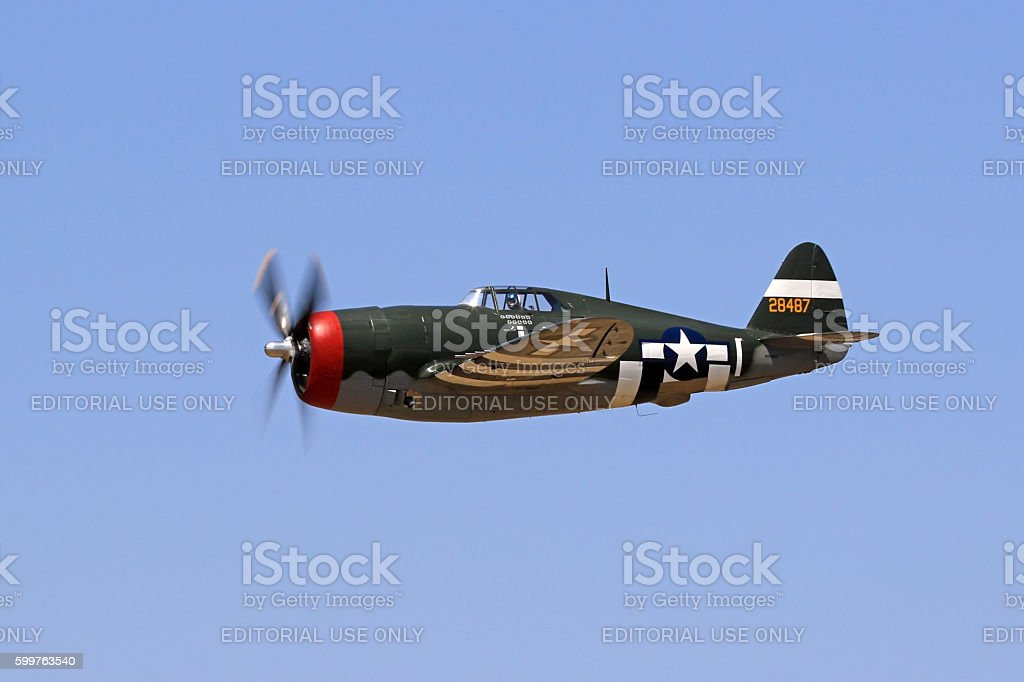 Airplane WWII P-47 Thunderbolt flying stock photo