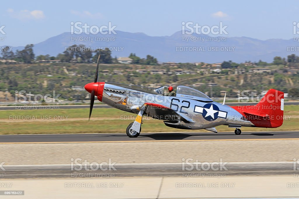 Airplane WWII P-51 Mustang on runway stock photo