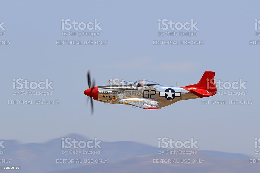 Airplane WWII P-51 Mustang Red Tail stock photo