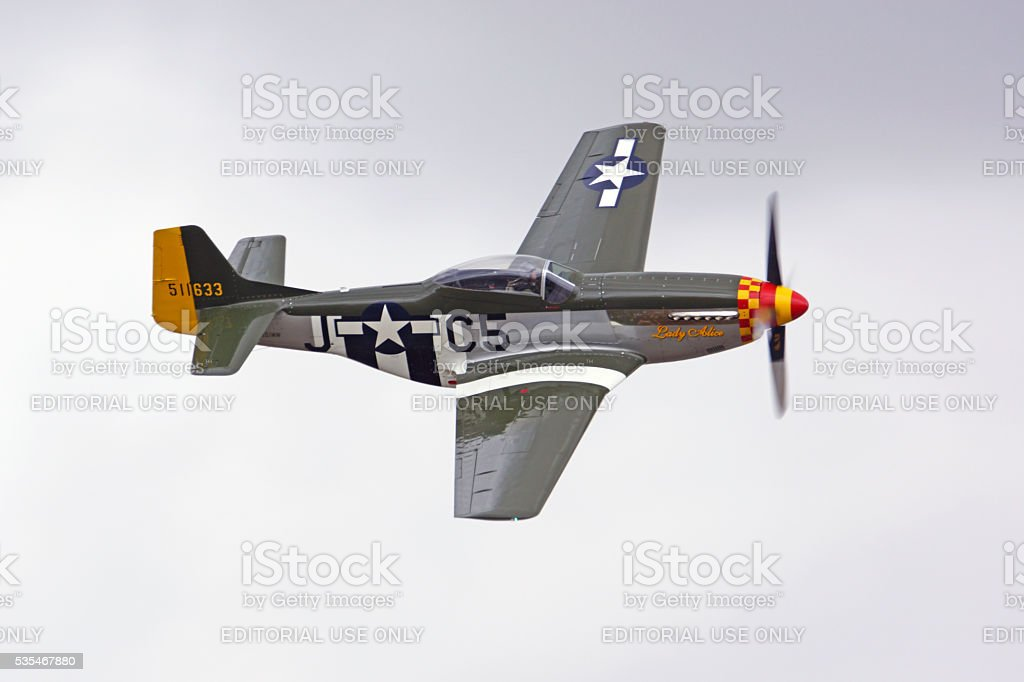 Airplane WWII vintage P-51 fighter flying at air show stock photo