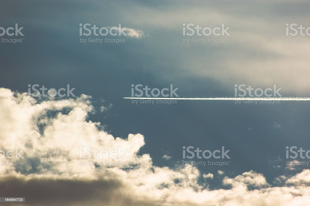 Airplane/jet soars across sky into clouds. royalty-free stock photo