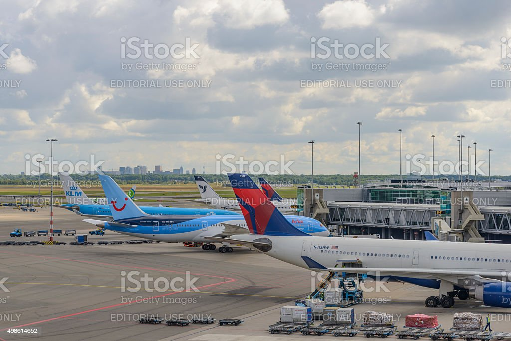 Airplanes at the tarmac of Schiphol Airport stock photo