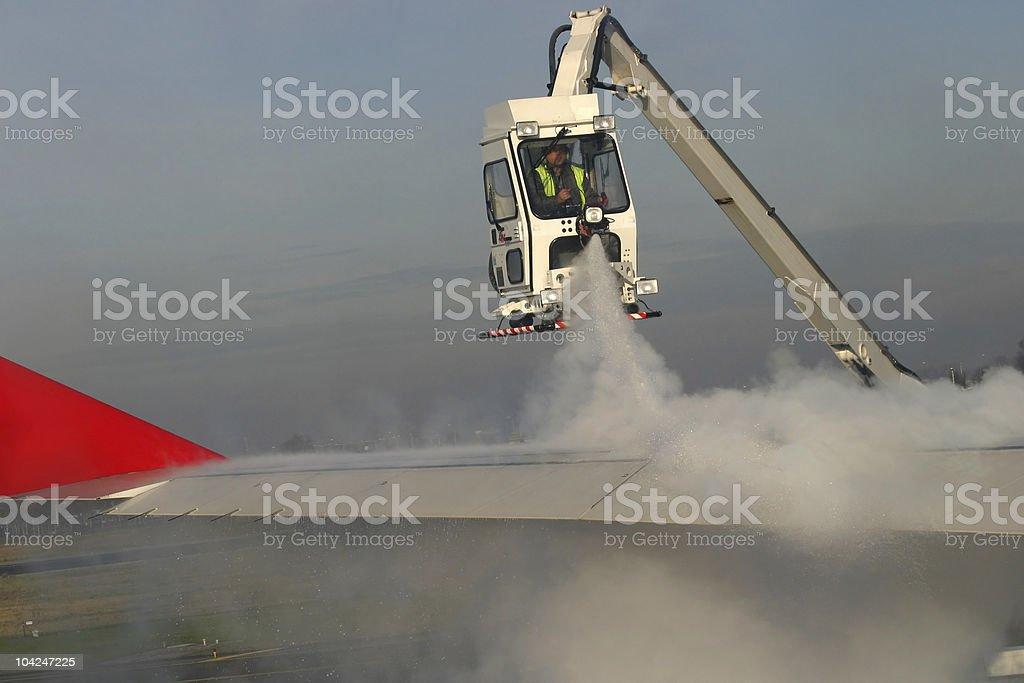 Airplane's de-icing stock photo