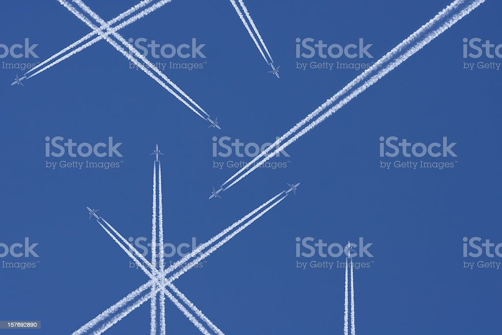 Airplanes in a Blue Sky with Vapor Trail, Air Traffic stock photo