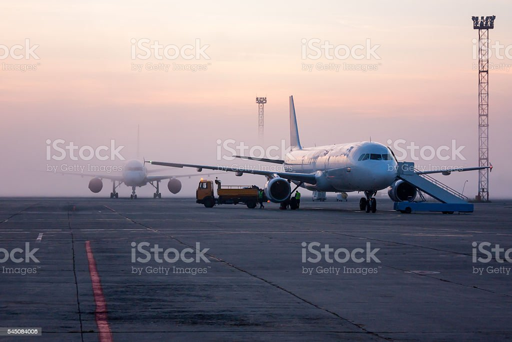 Airplanes is covered with fog royalty-free stock photo