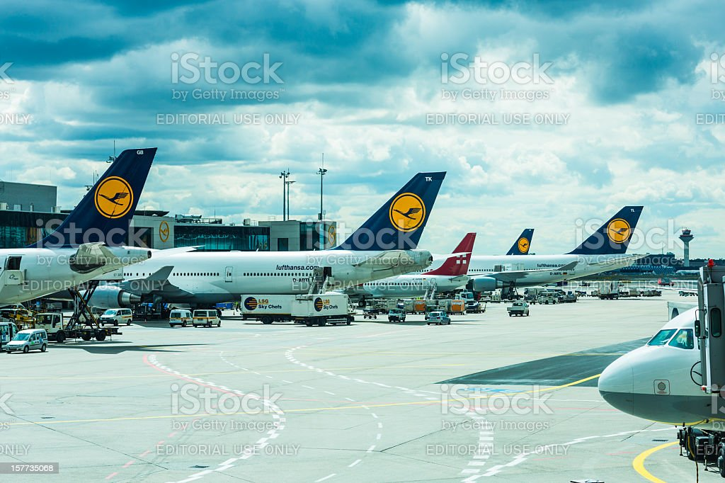 Airplanes loading at airport Frankfurt am Main royalty-free stock photo