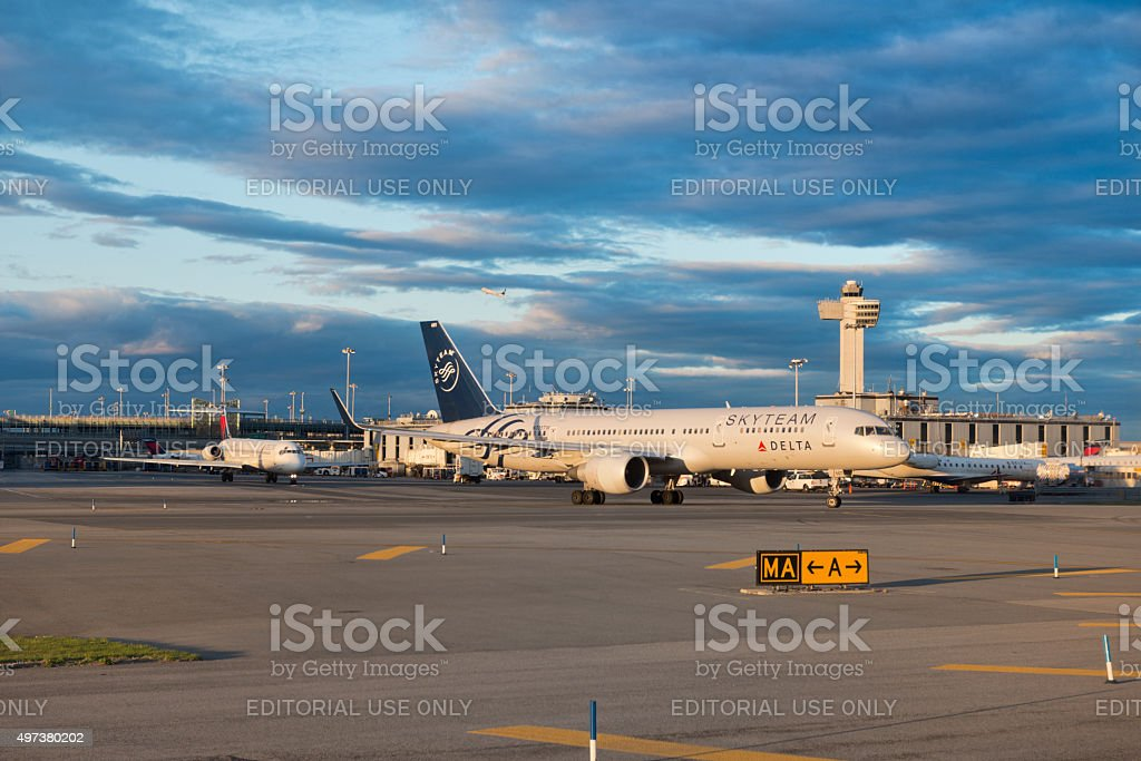 Airplanes loading on airport JFK, New York stock photo