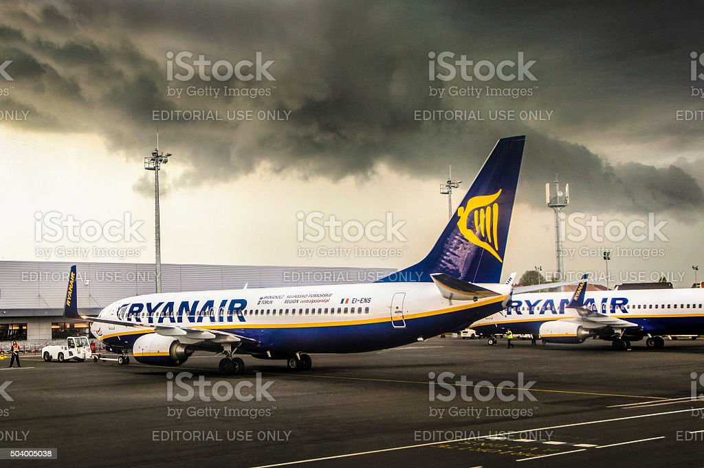 Airplanes on airport during a tunderstorm stock photo