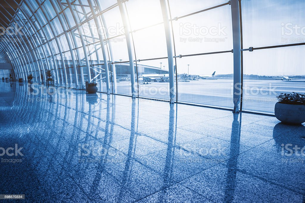 Airplanes On Airport Runway Seen Through Glass Window stock photo
