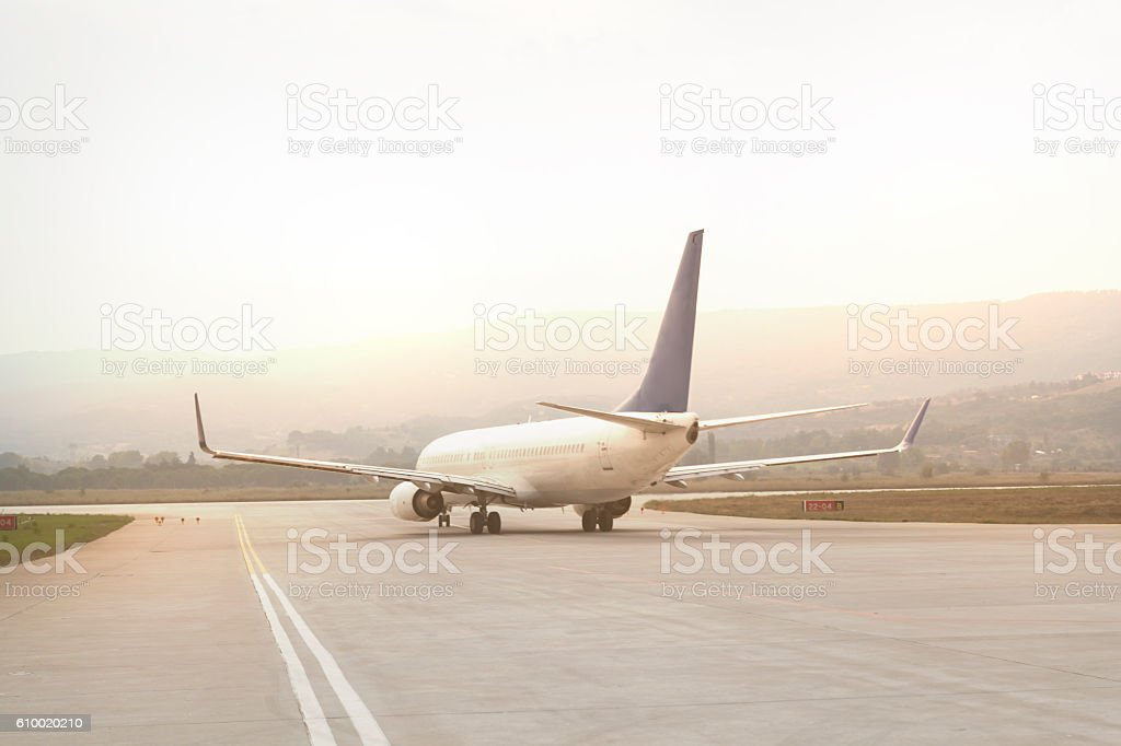 Airplanes on port at sunset stock photo