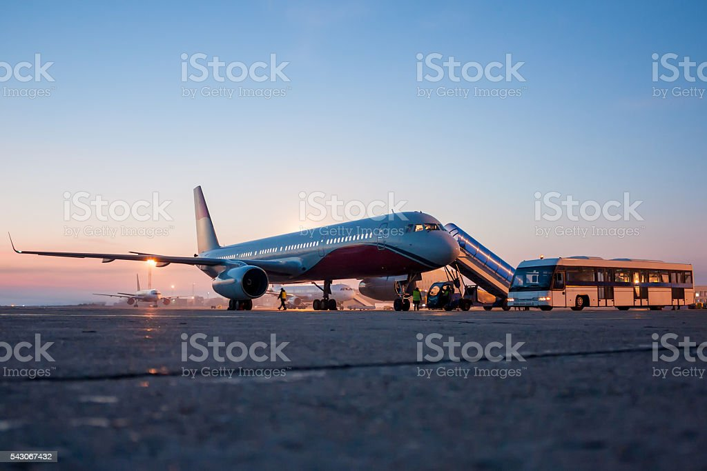 Airplanes on the early morning airport apron stock photo