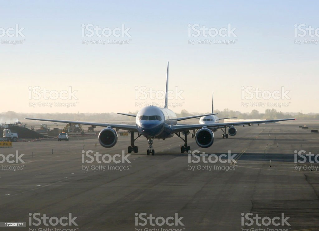 Airplanes Taxiing On Runway stock photo