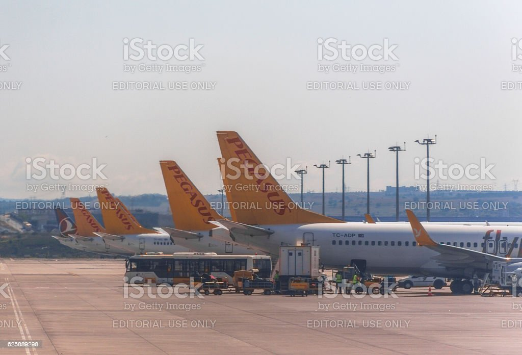 Airplanes waiting at sabiha-gokcen airport istanbul turkey stock photo
