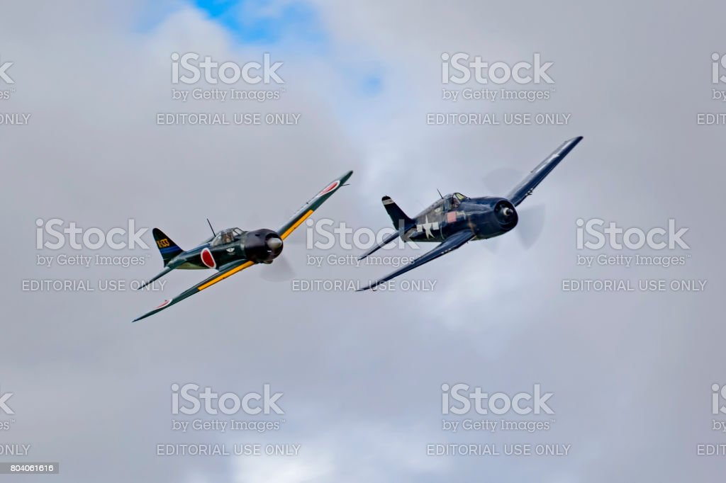 Airplanes WWII F-6F Hellcat and Misubishi Zero aircraft during an air show aerial dog fight stock photo