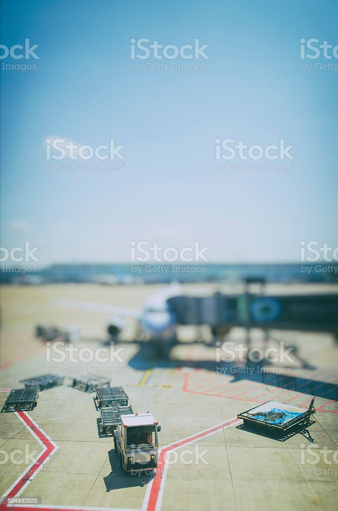 Airport Activity with Baggage Handling Vehicle and Aeroplane stock photo