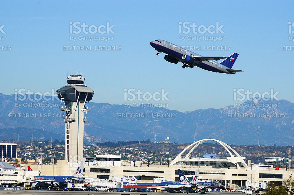 LAX Airport and Plane taking off stock photo